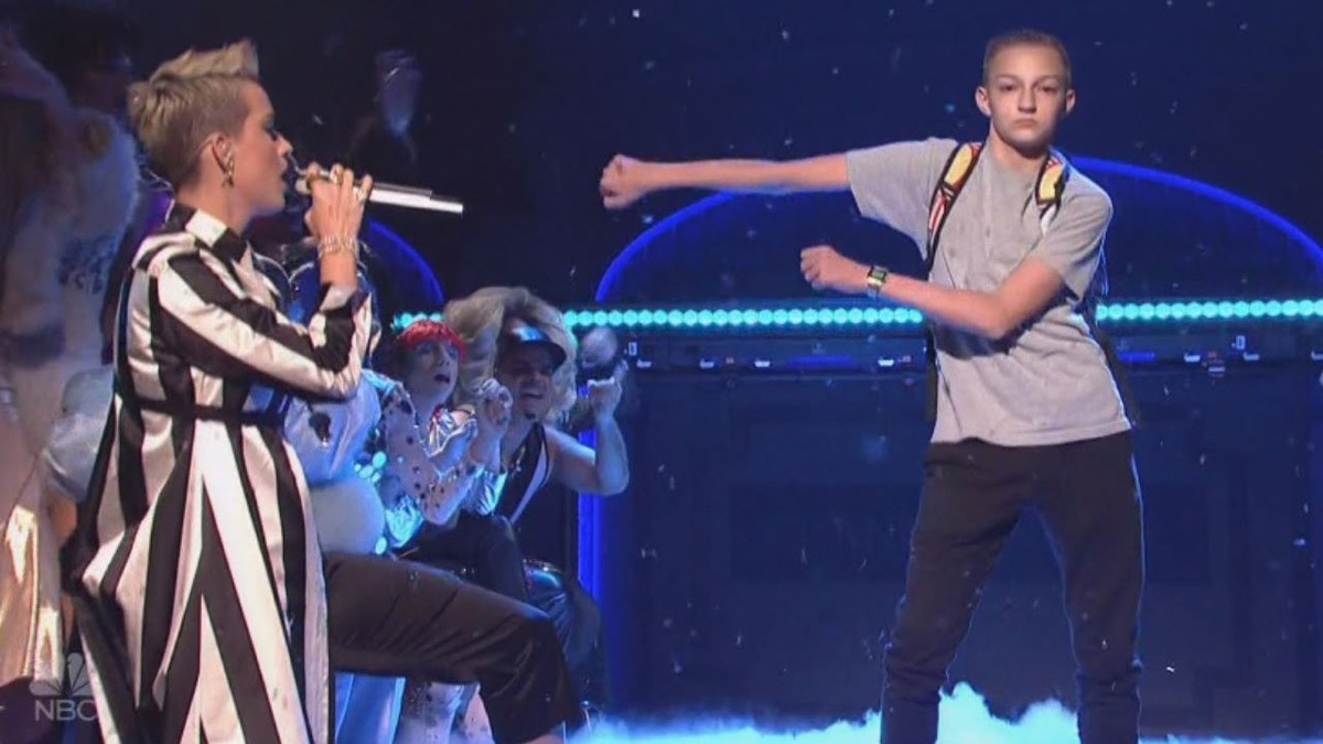 the backpack kid about to floss during katy perry's performance of swish swish on snl