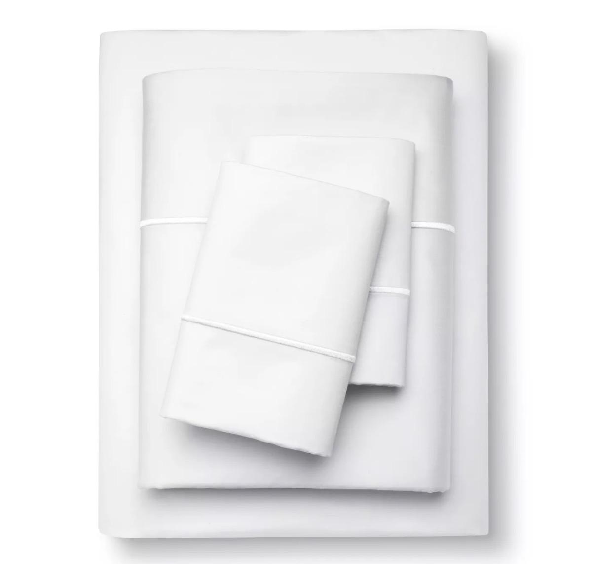 white cotton sheet set with two pillowcases