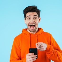 Surprised man with phone