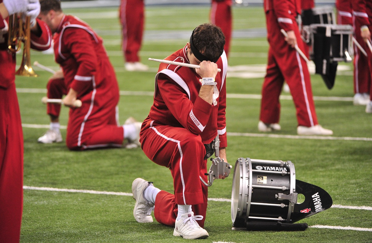marching band member tebowing