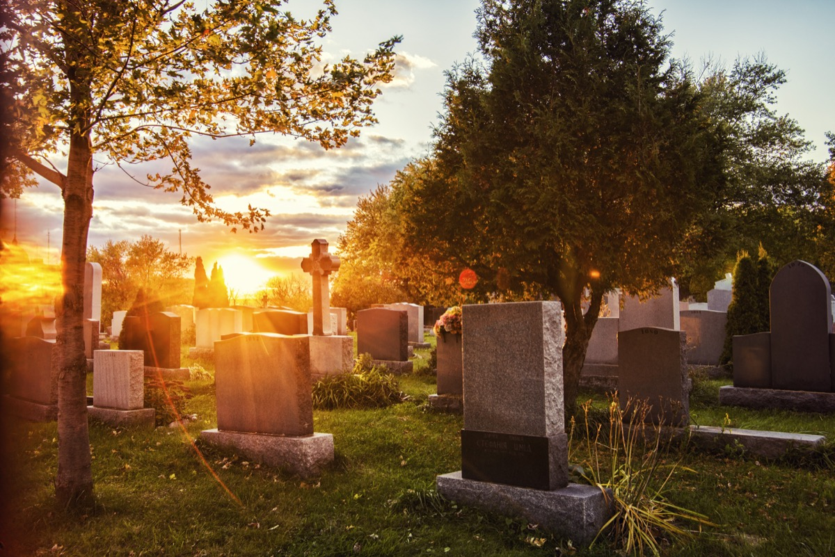 a cemetery during sunrise