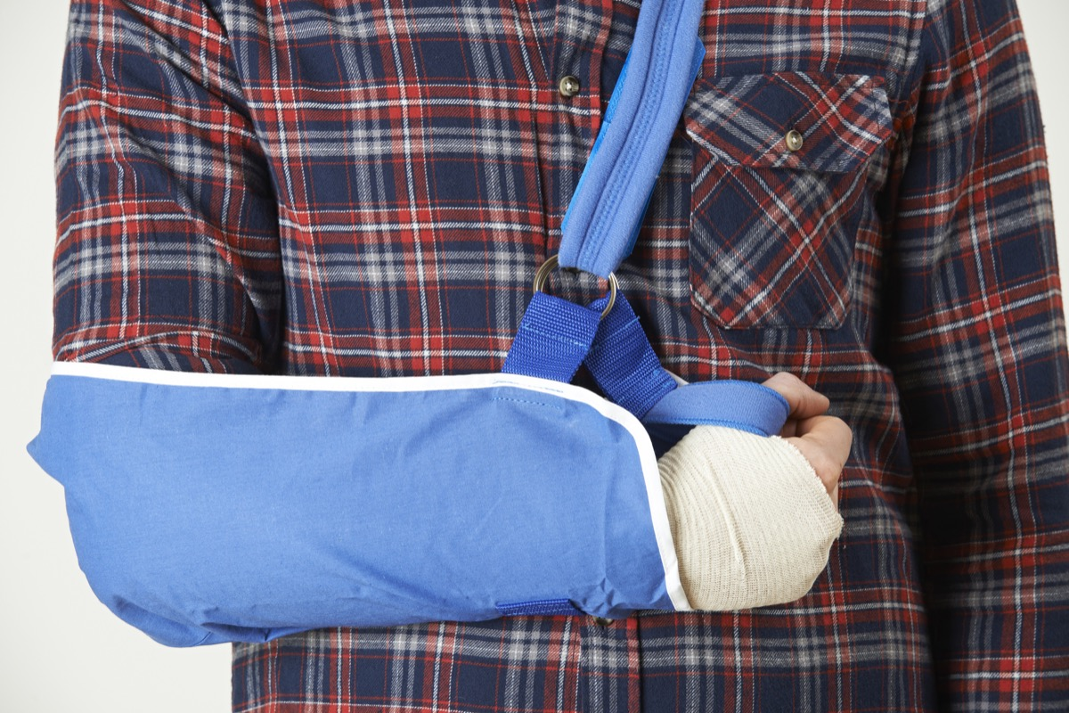 man in an arm sling