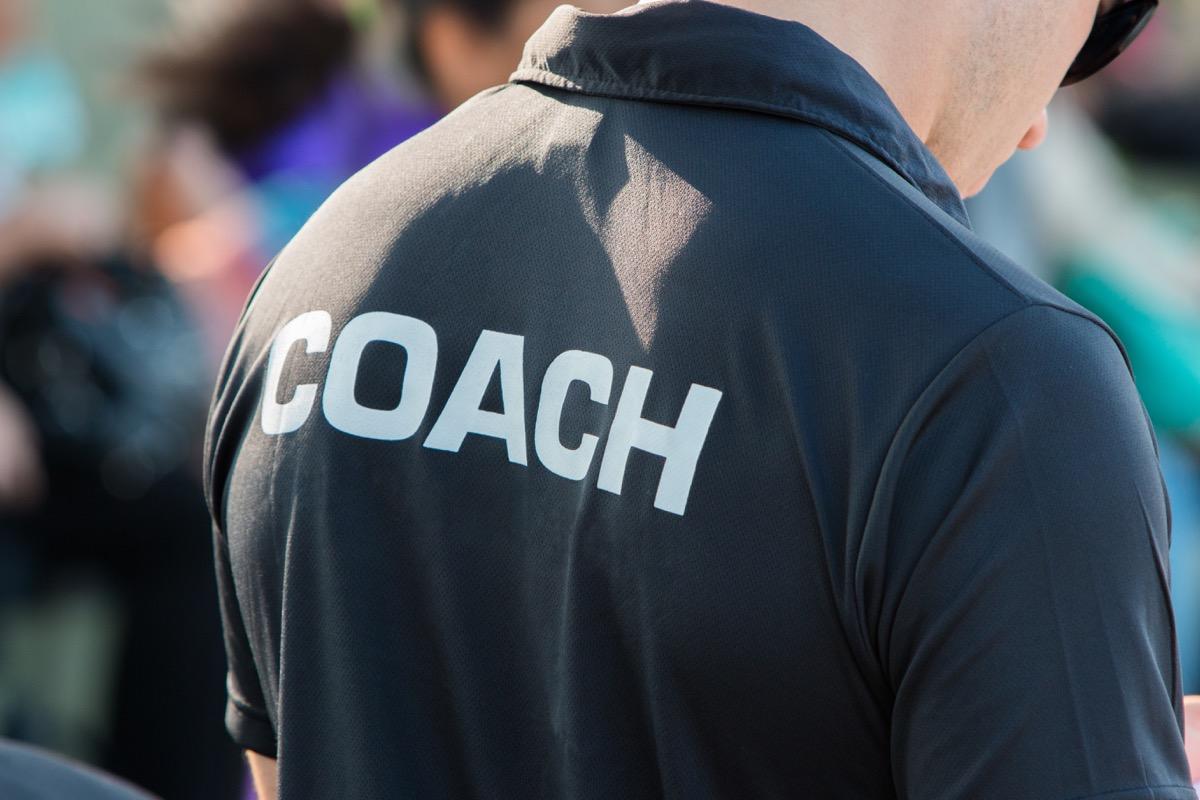 back of coach's black shirt