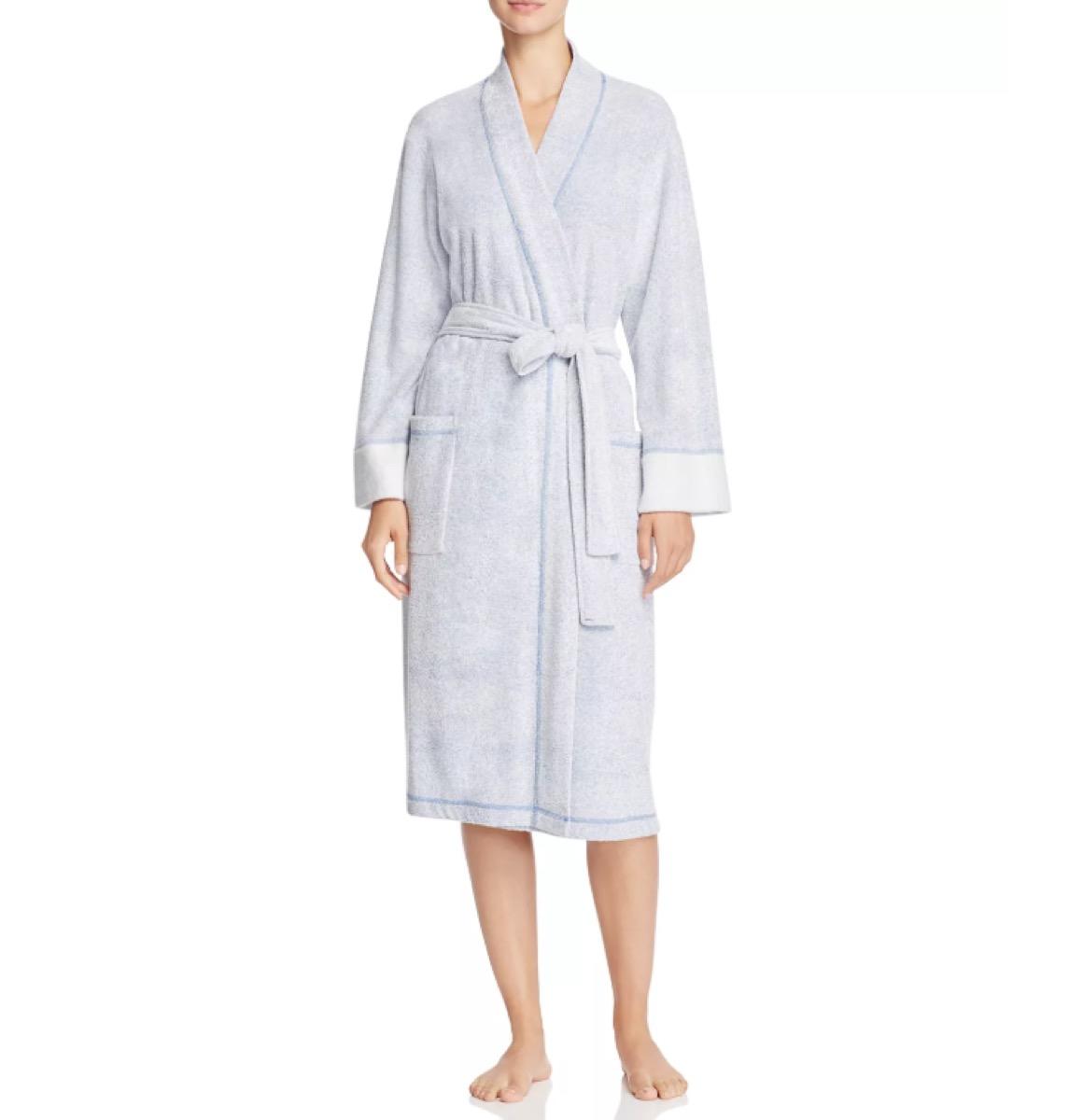 white woman in light blue bathrobe