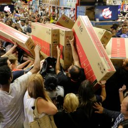 Shoppers rush to buy televisions during a chaotic Black Friday sale