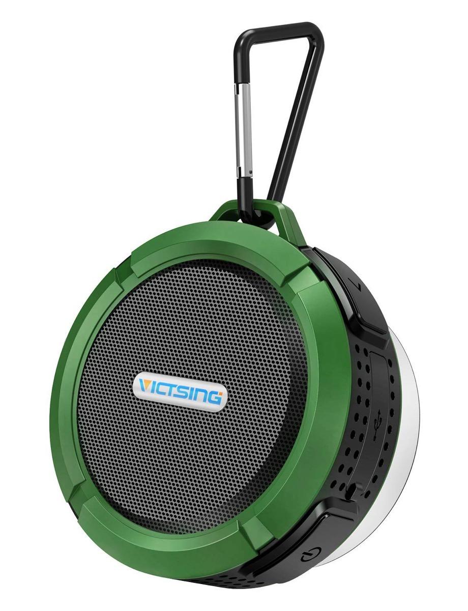 green bluetooth speaker on a carabiner