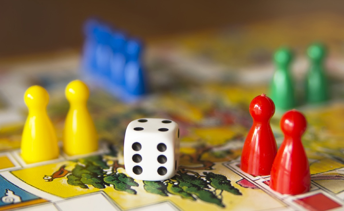 die and game pieces on a game board
