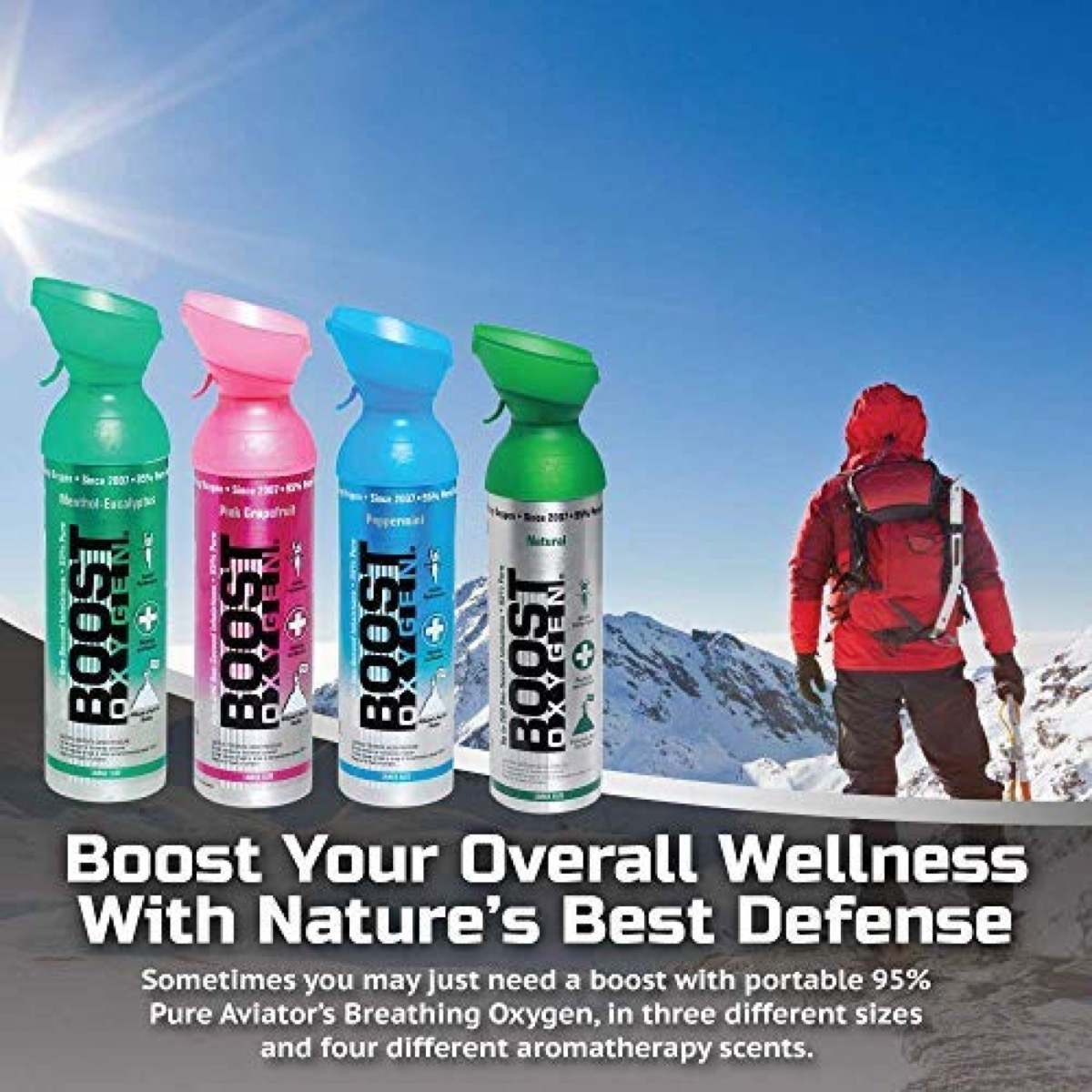 man in red jacket on mountaintop and four bottles of boost oxygen