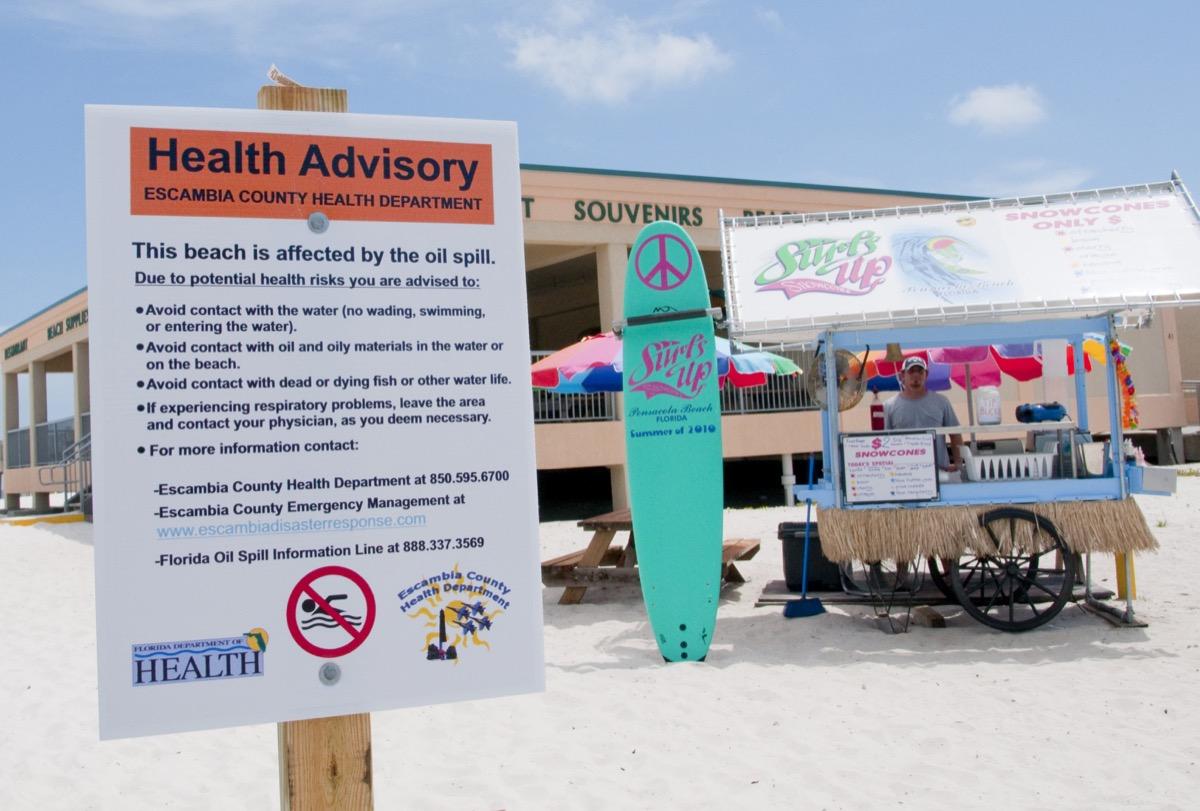 bp oil spill sign on the beach
