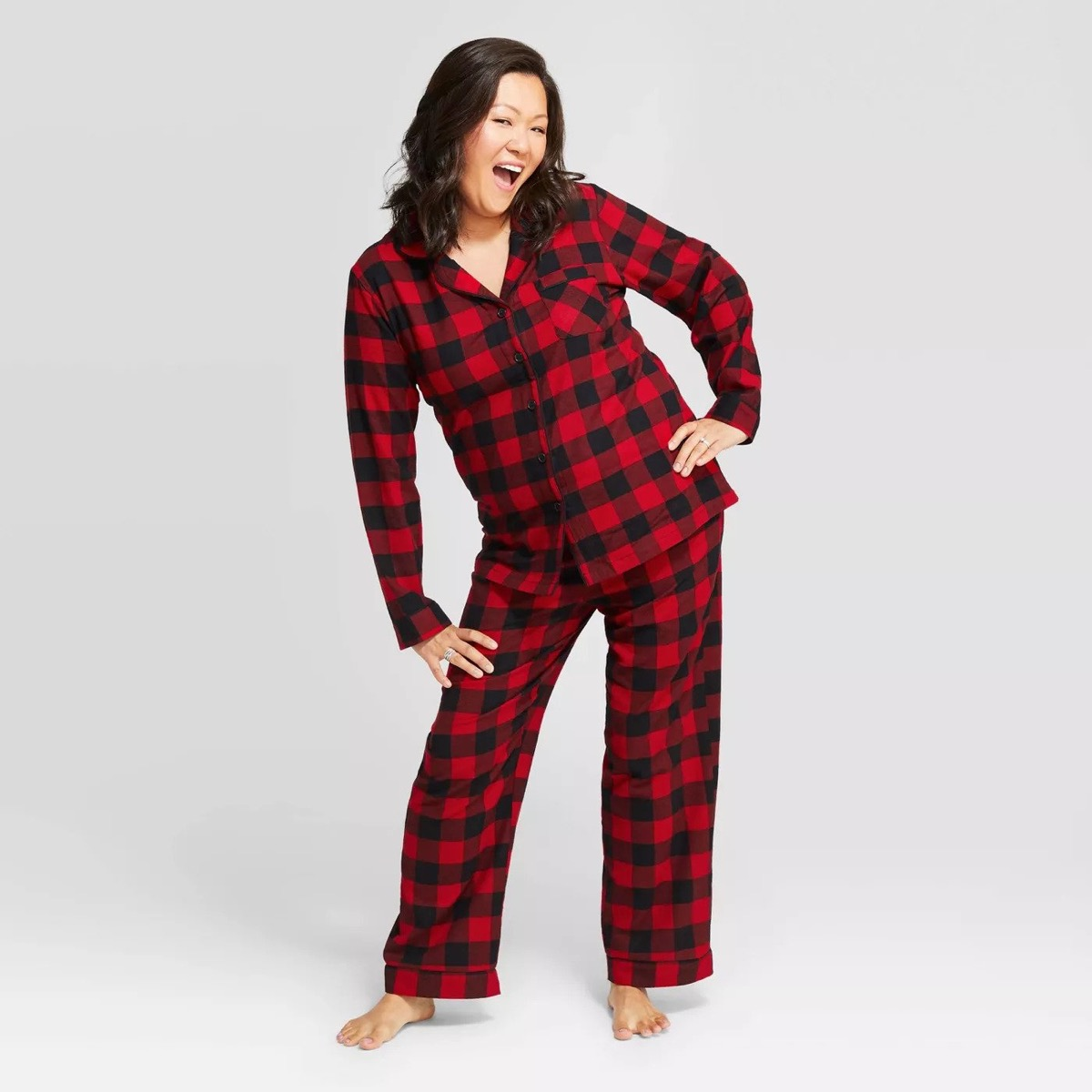 30-something asian woman in red and black pajamas