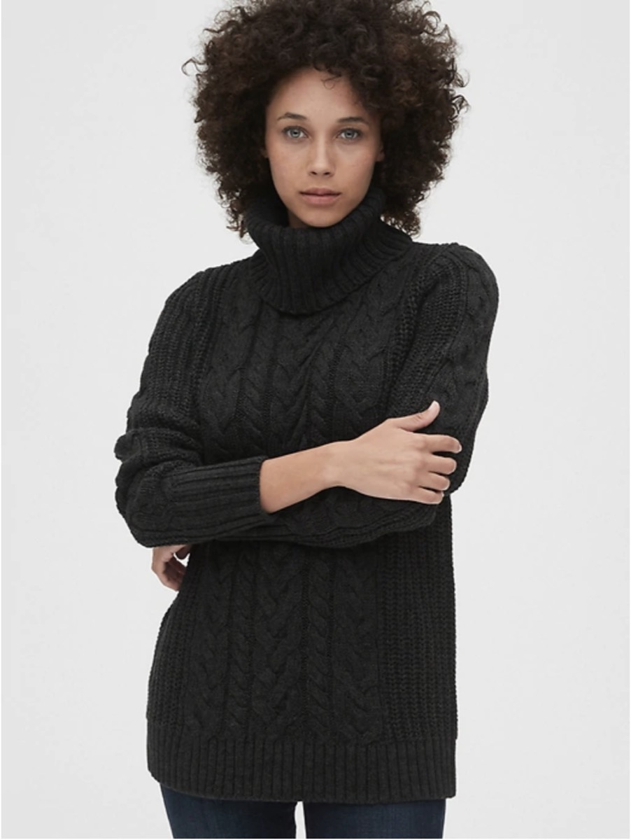 black woman wearing gray cable knit turtleneck