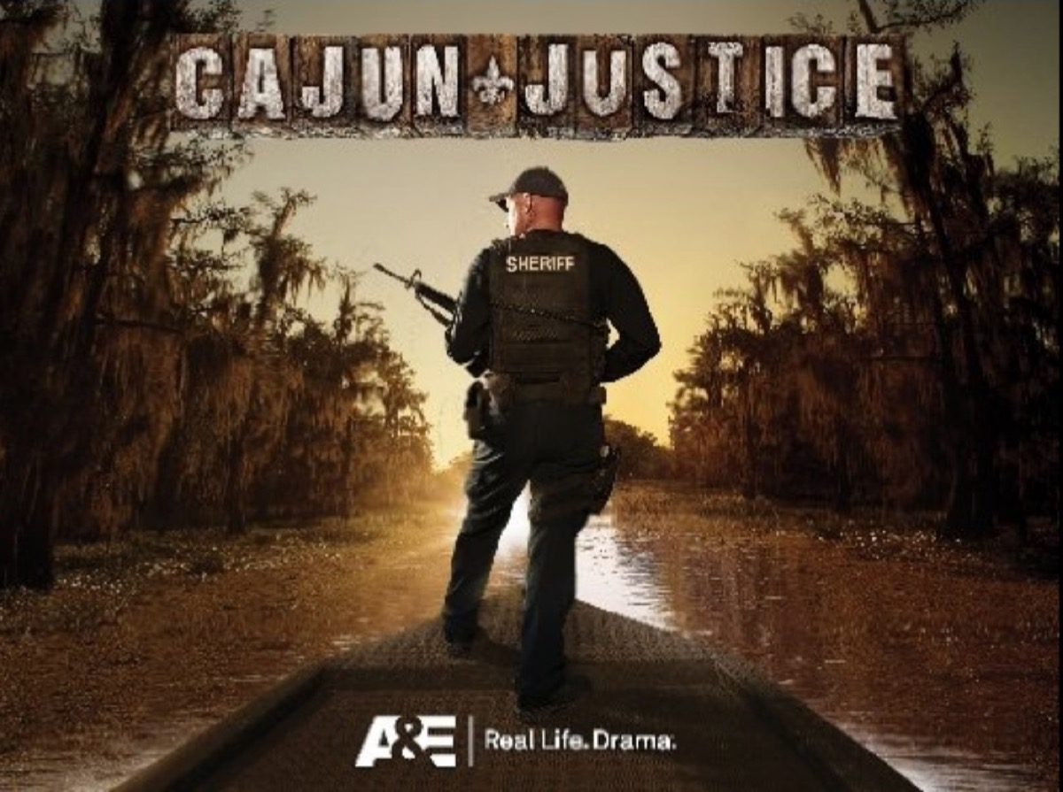"""man on boat holding spear gun in the bayou with words """"cajun justice"""" over his head"""