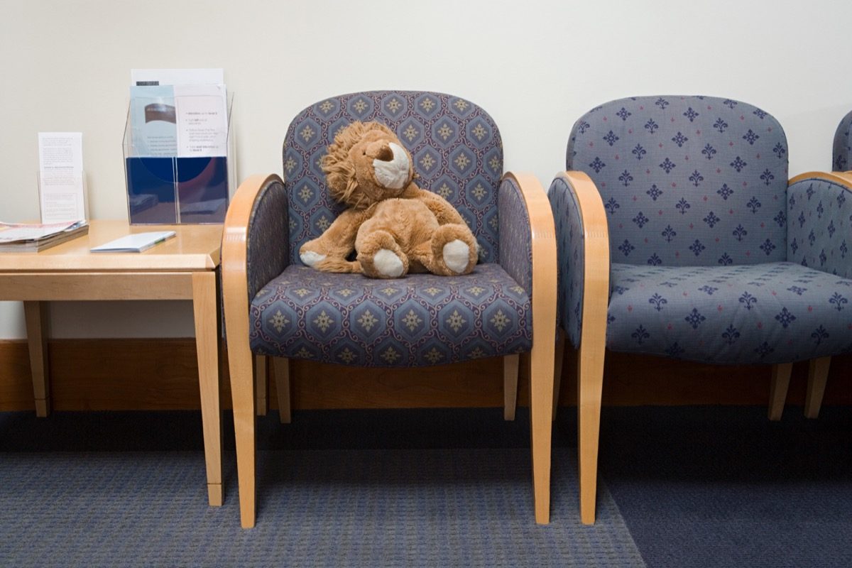 chairs and toy lion in doctors waiting room
