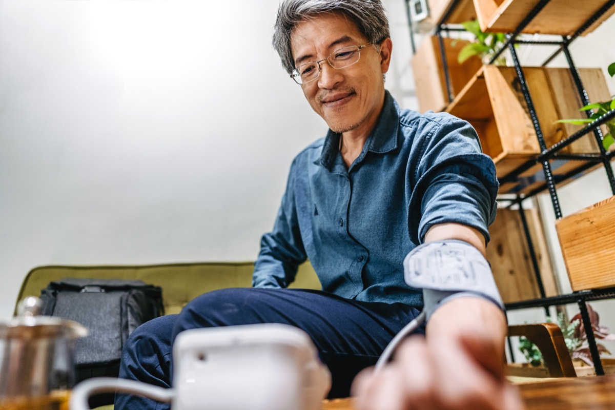 Asian man getting his blood pressure checked