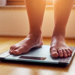 Person on the scale checking their weight