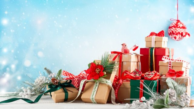 Christmas or New Year background with festive gift boxes
