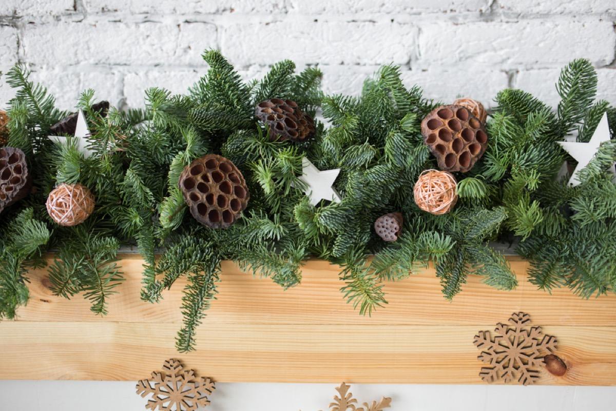 pine garland on wooden mantle