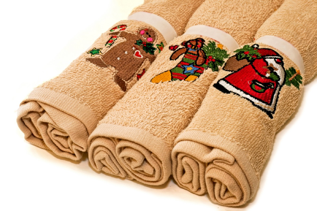 three rolled up holiday kitchen towels