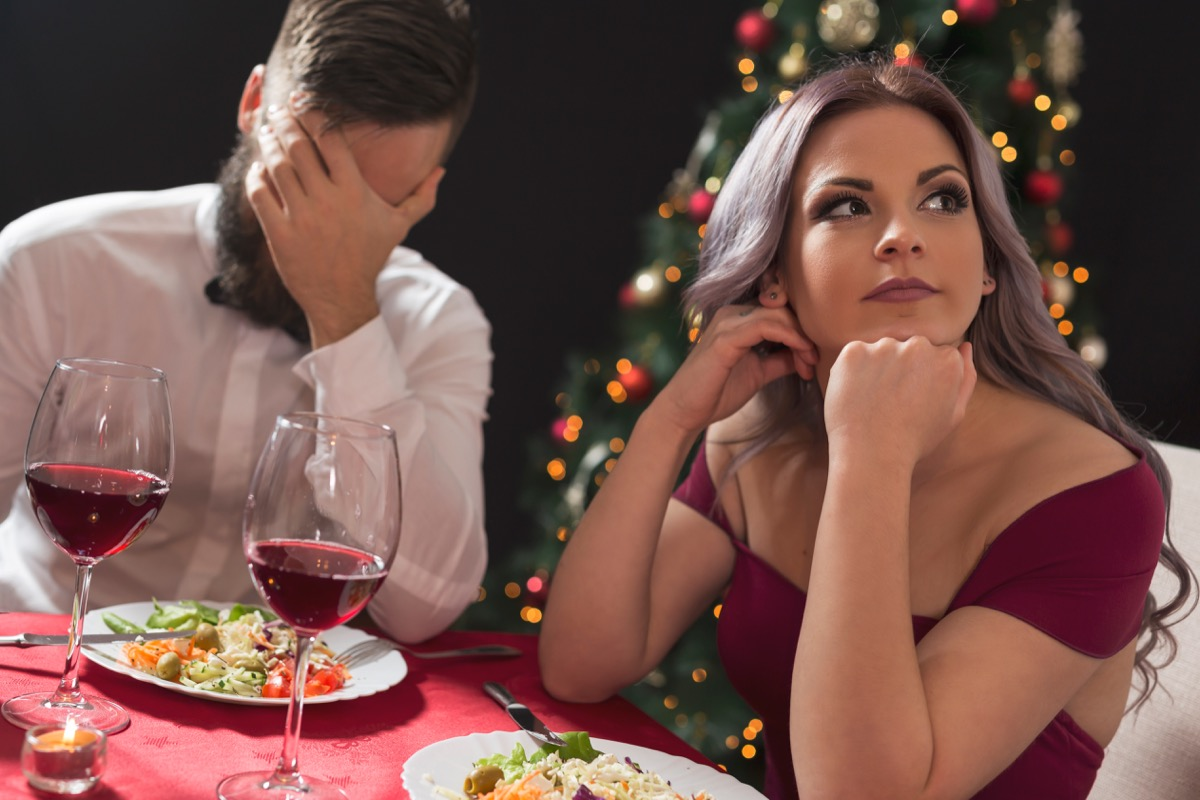 Couple arguing during christmas dinner