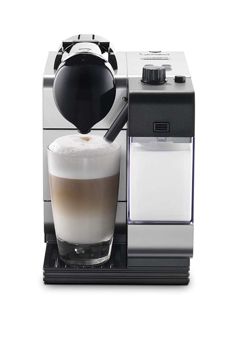 black espresso and cappuccino machine with clear mug of cappuccino on white background