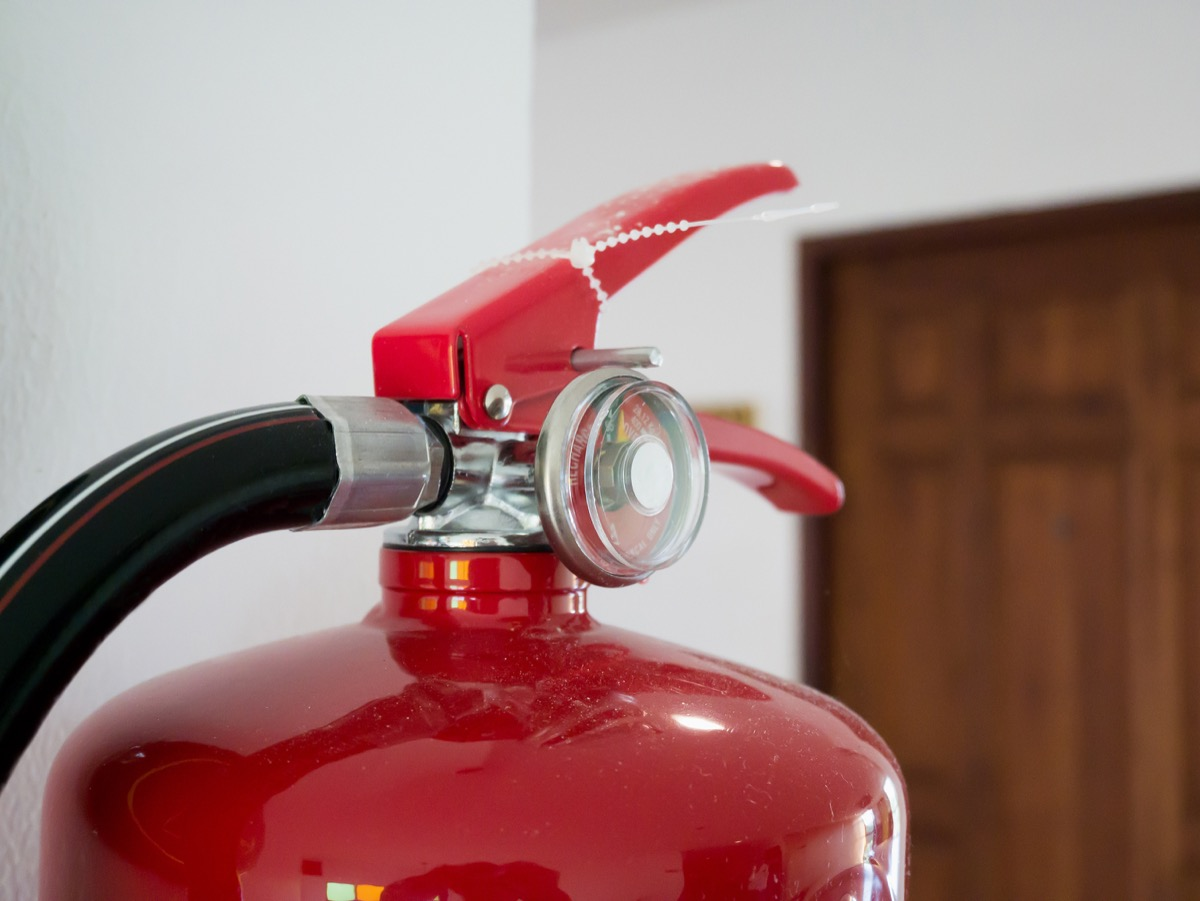 fire extinguisher in home on the counter