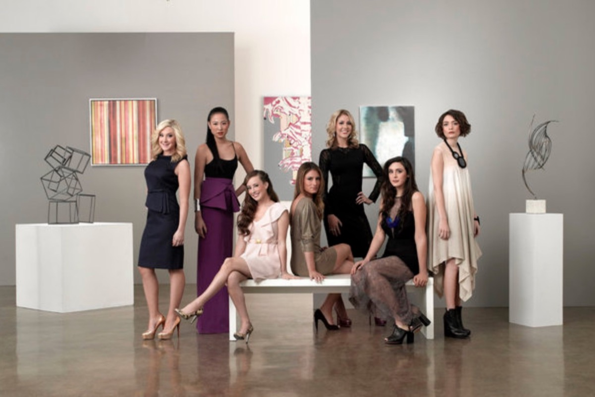 group of 20-something women standing in a gallery