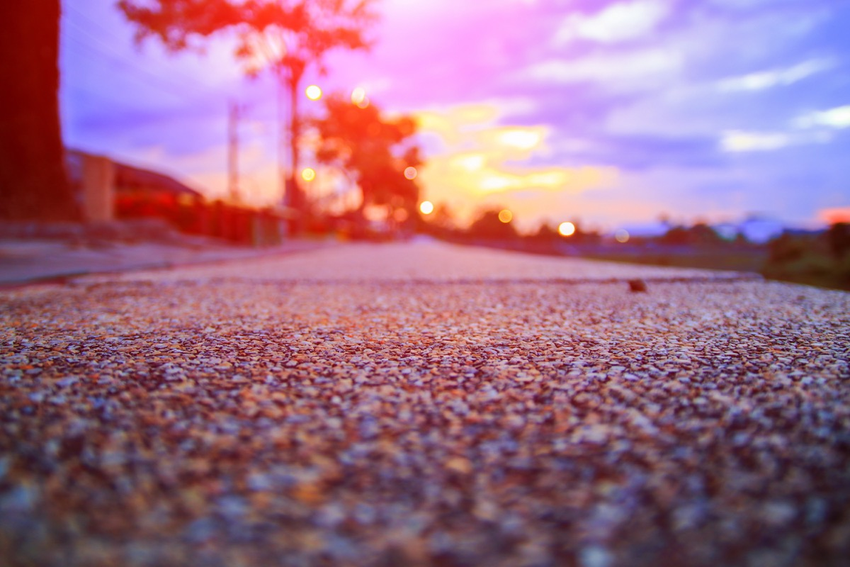 gravel driveway against a sunset