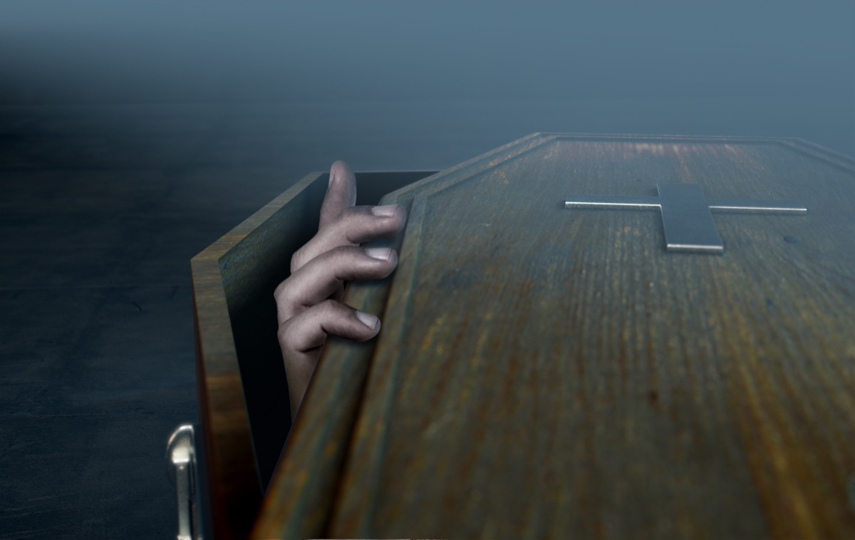 hand coming out of coffin