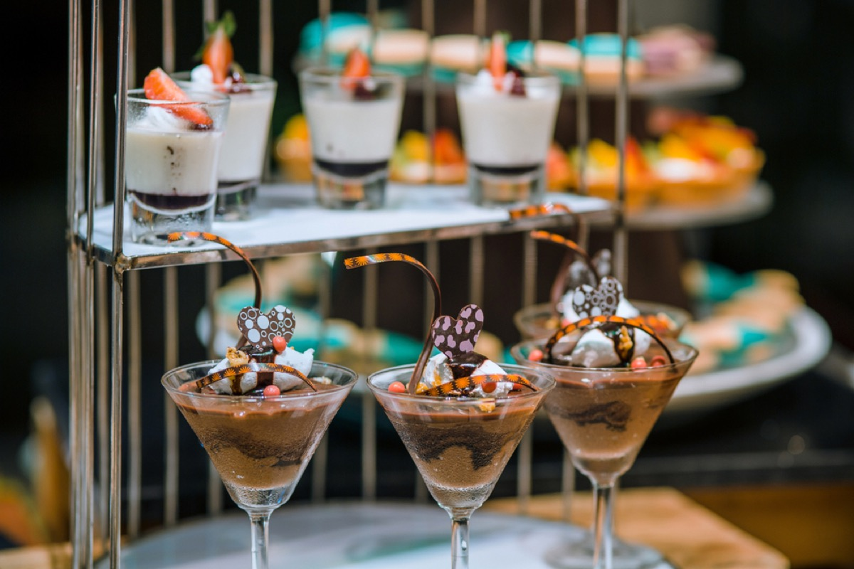 martini glasses full of mousse and ice cream on counter