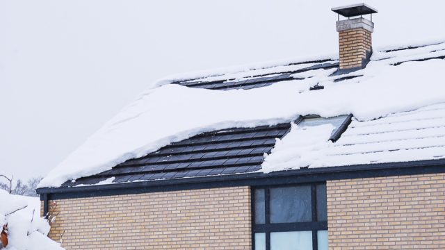 home covered in snow on the roof