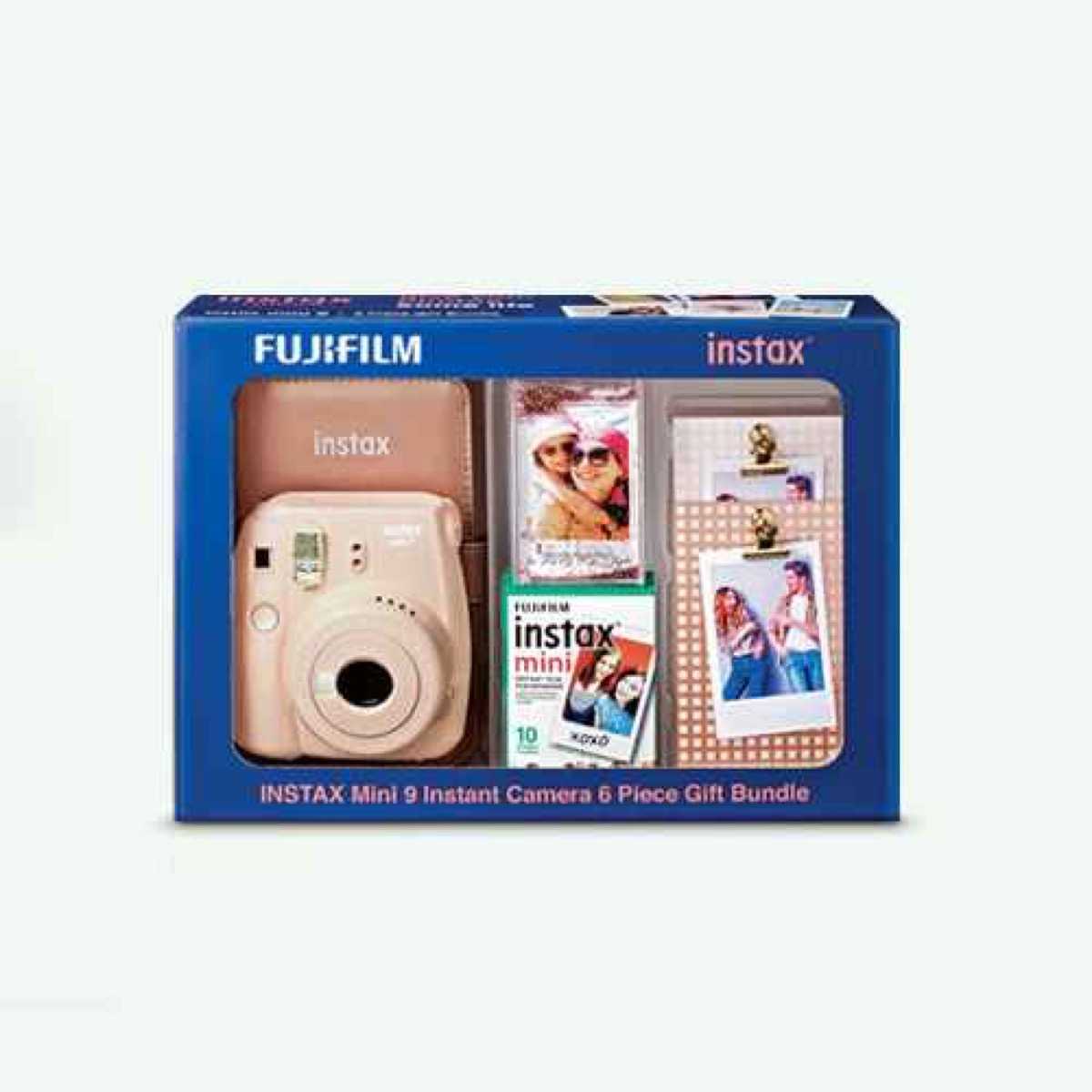 pink fujifilm instax camera and film