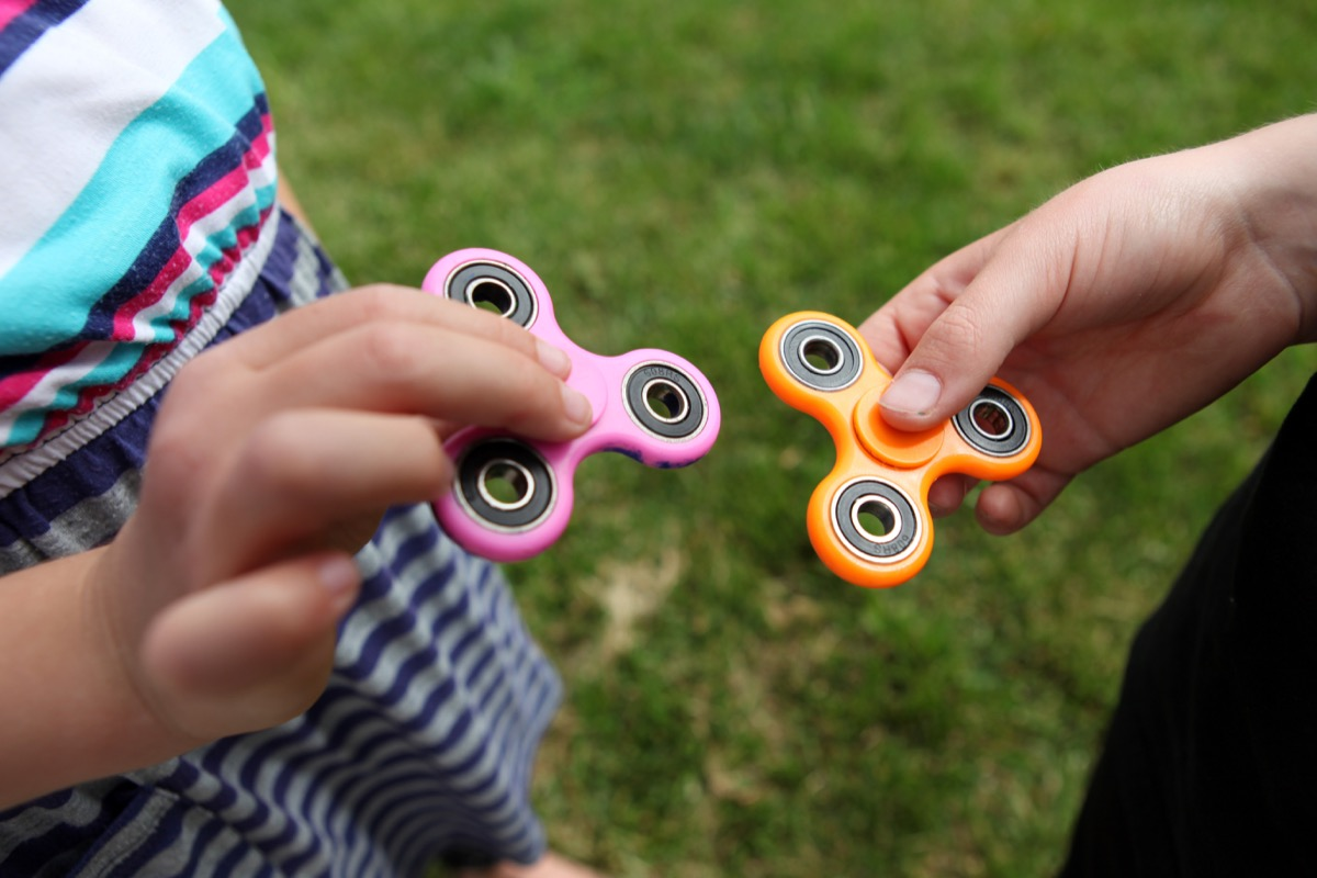 kids playing with fidget spinners