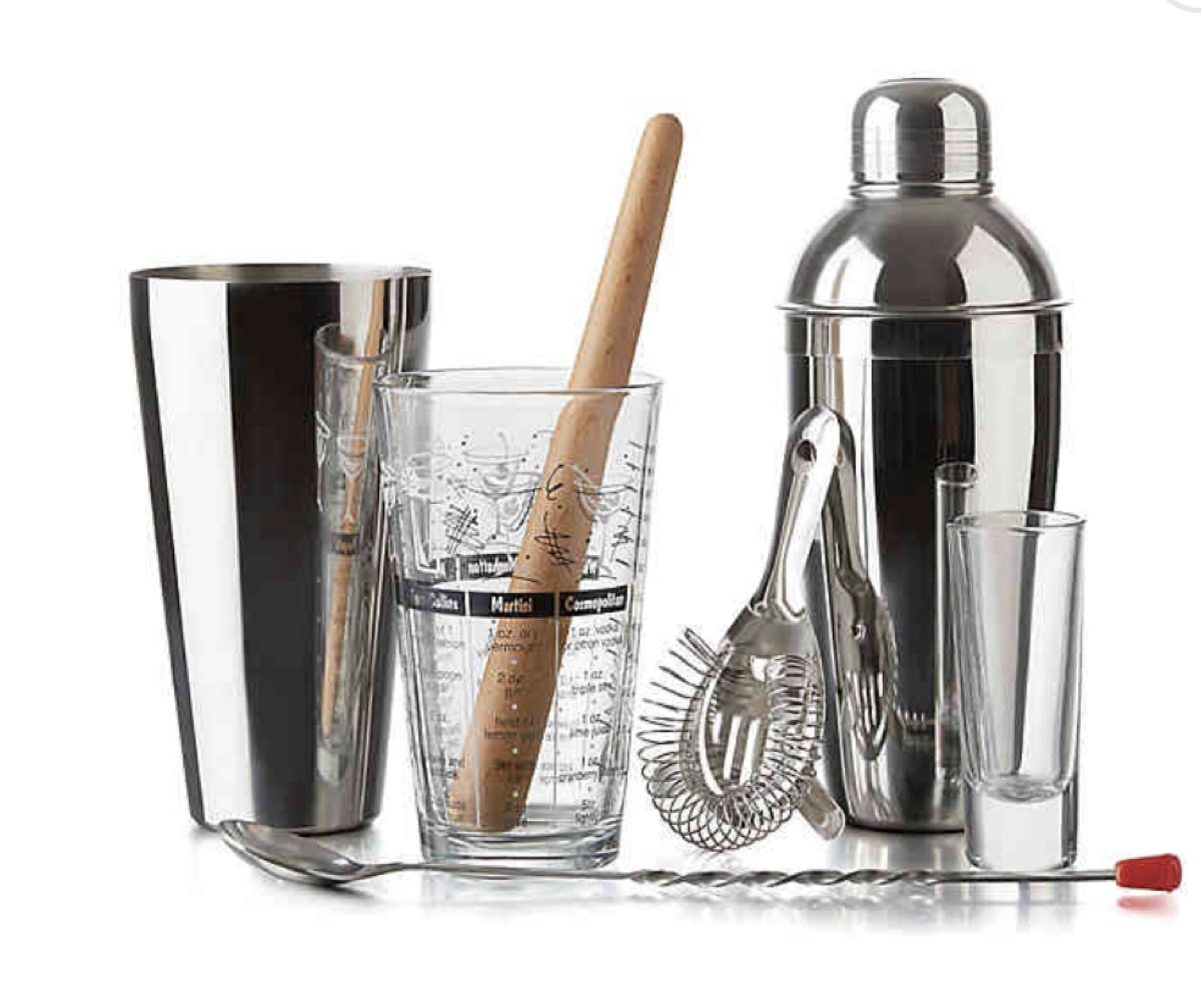 cocktail set with wooden muddler, silver cup, and silver shaker