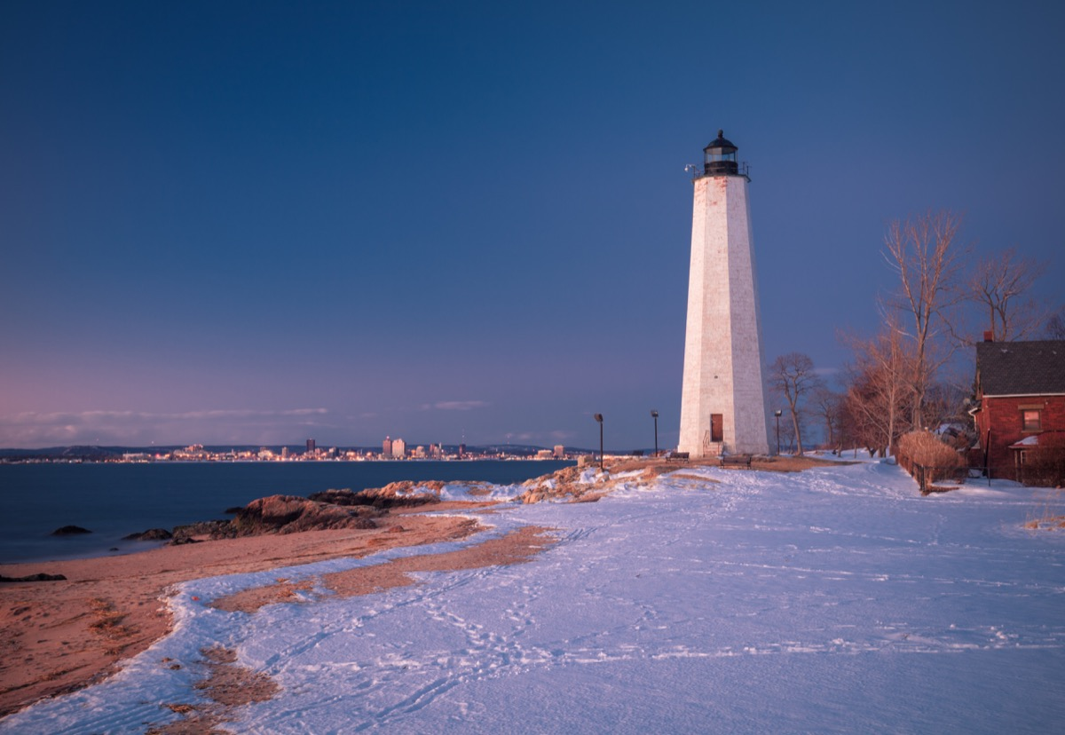 A lighthouse covered in snow in New Haven Connecticut