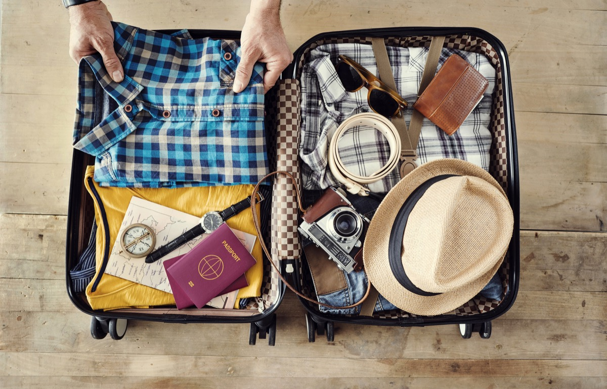 man packing his suitcase for travel