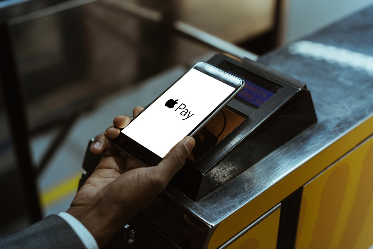 man paying with apple pay on public transport