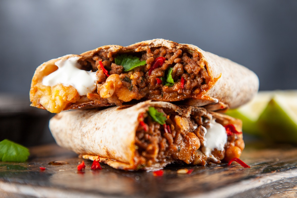 mexican beef burrito on a plate