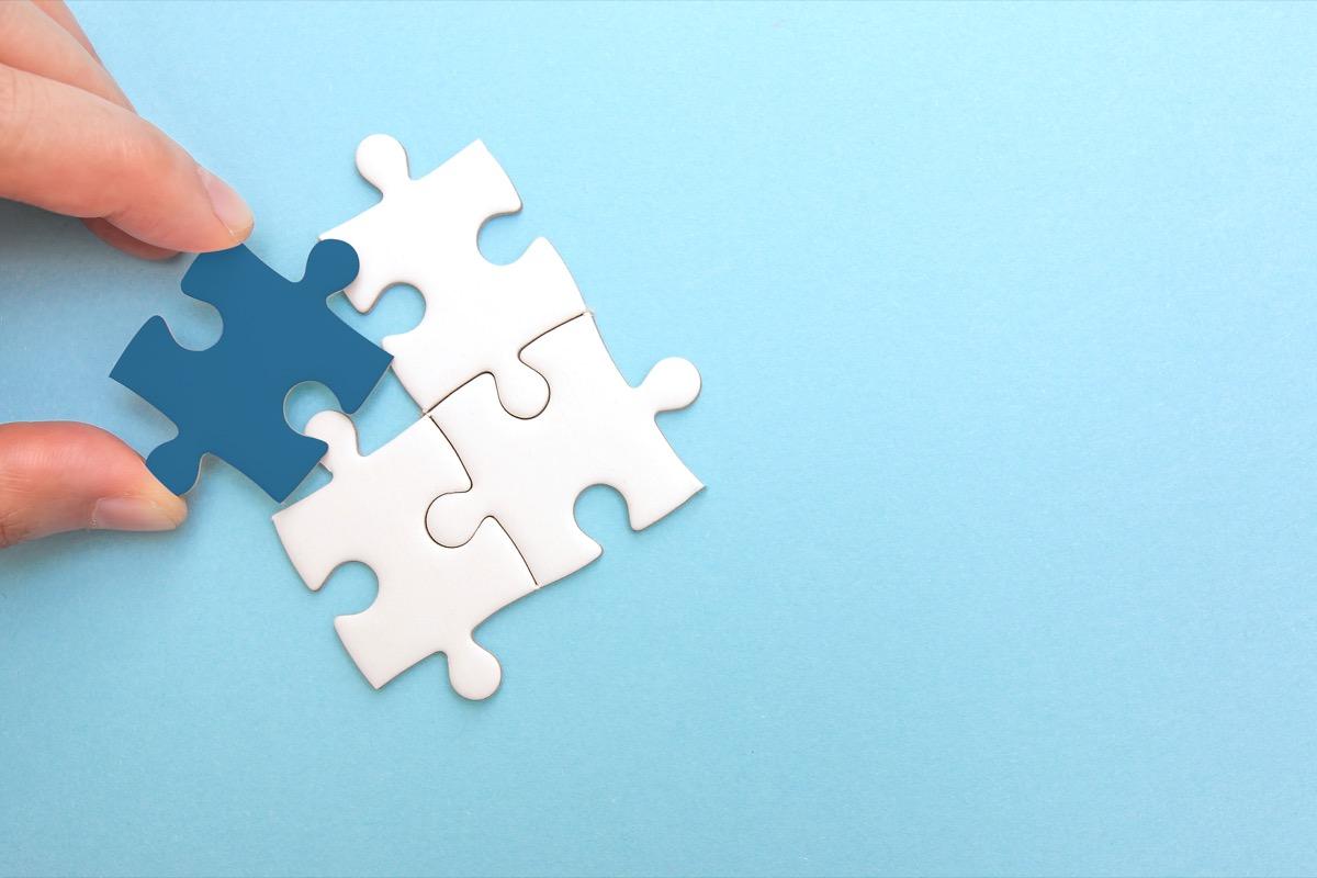mismatched puzzle pieces on blue background