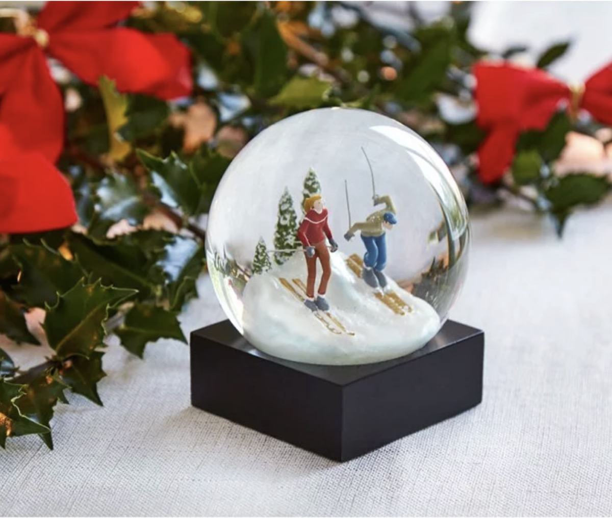 modern snow globe with skiing figures inside