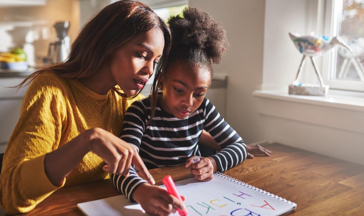 mother homeschooling daughter