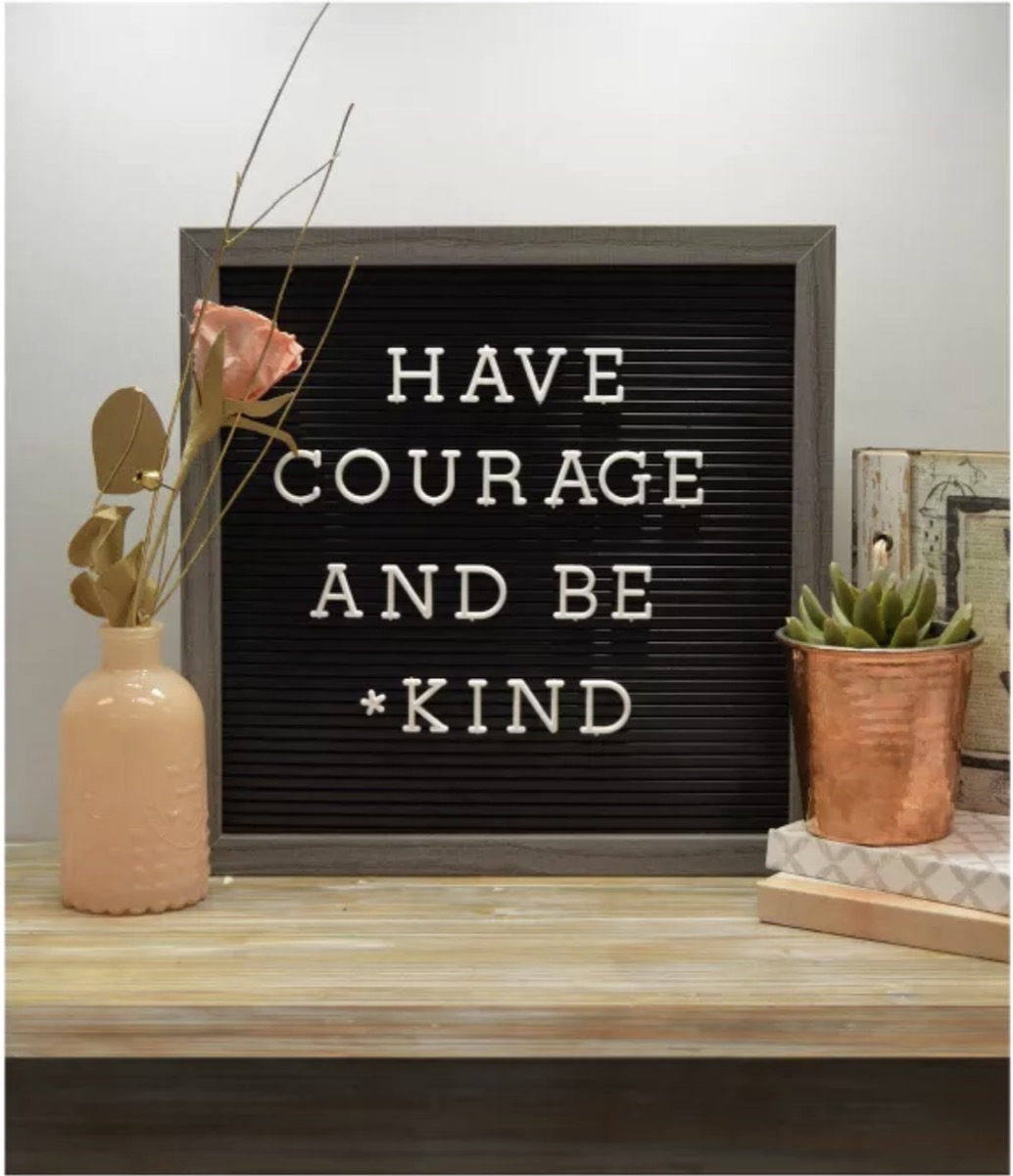 """black letter board with """"have courage and be kind"""" on it"""