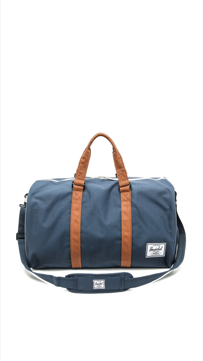blue weekender with brown leather straps