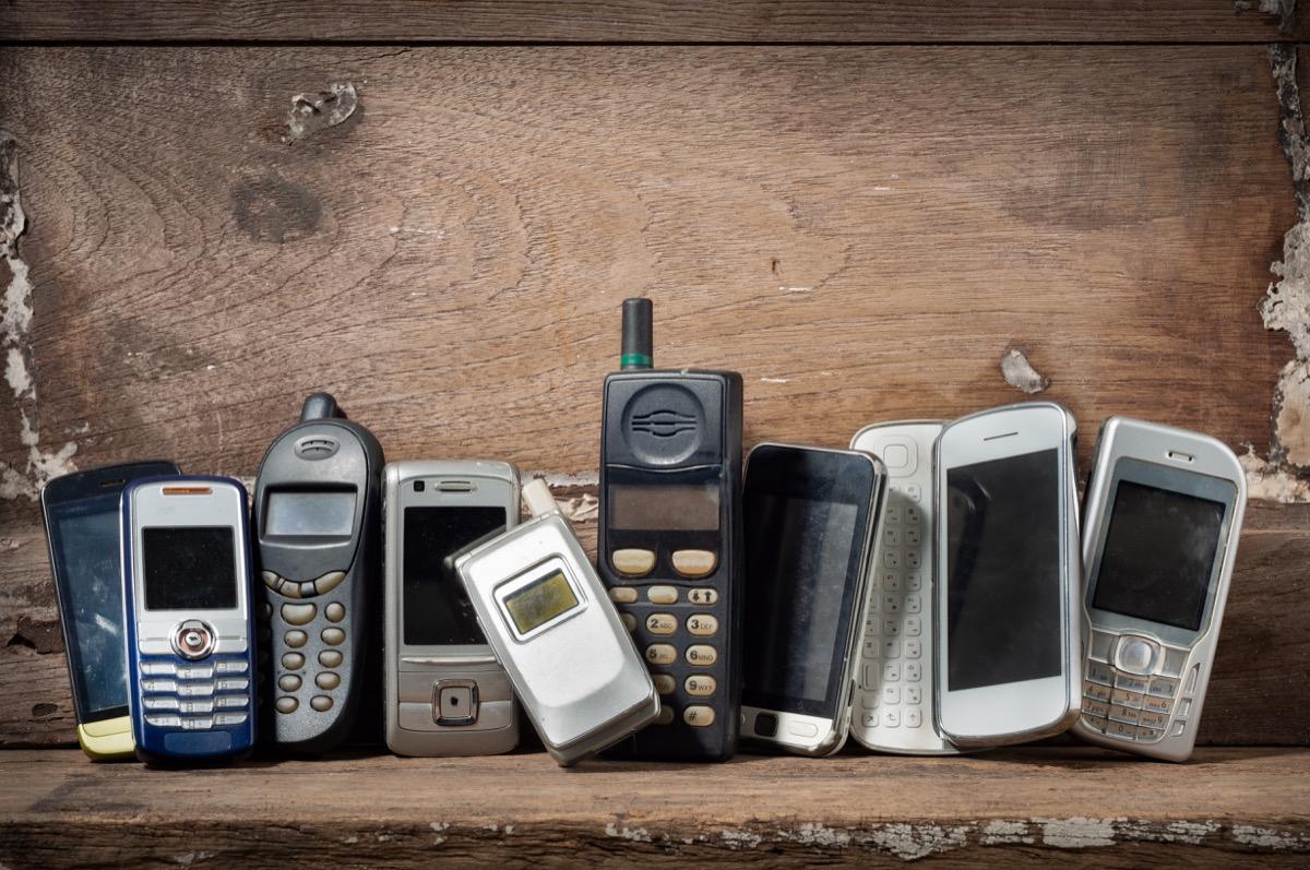 old obsolete mobile phones on shelf