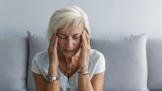 Woman having headache migraine