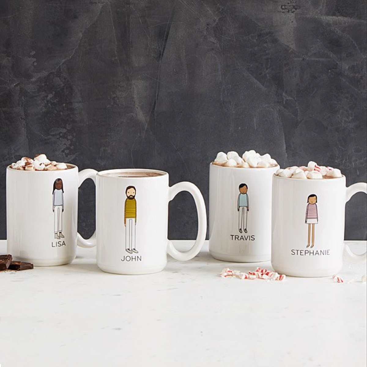 four white mugs with cartoon images and names on them