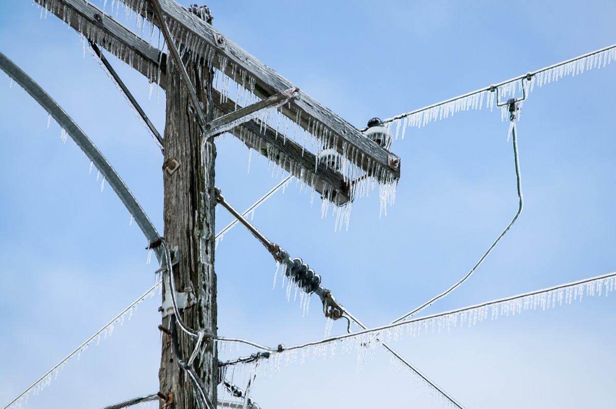 power line covered in ice in the air