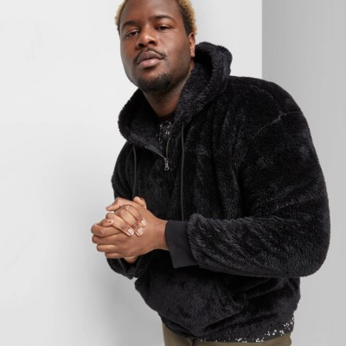 young black man in furry jacket
