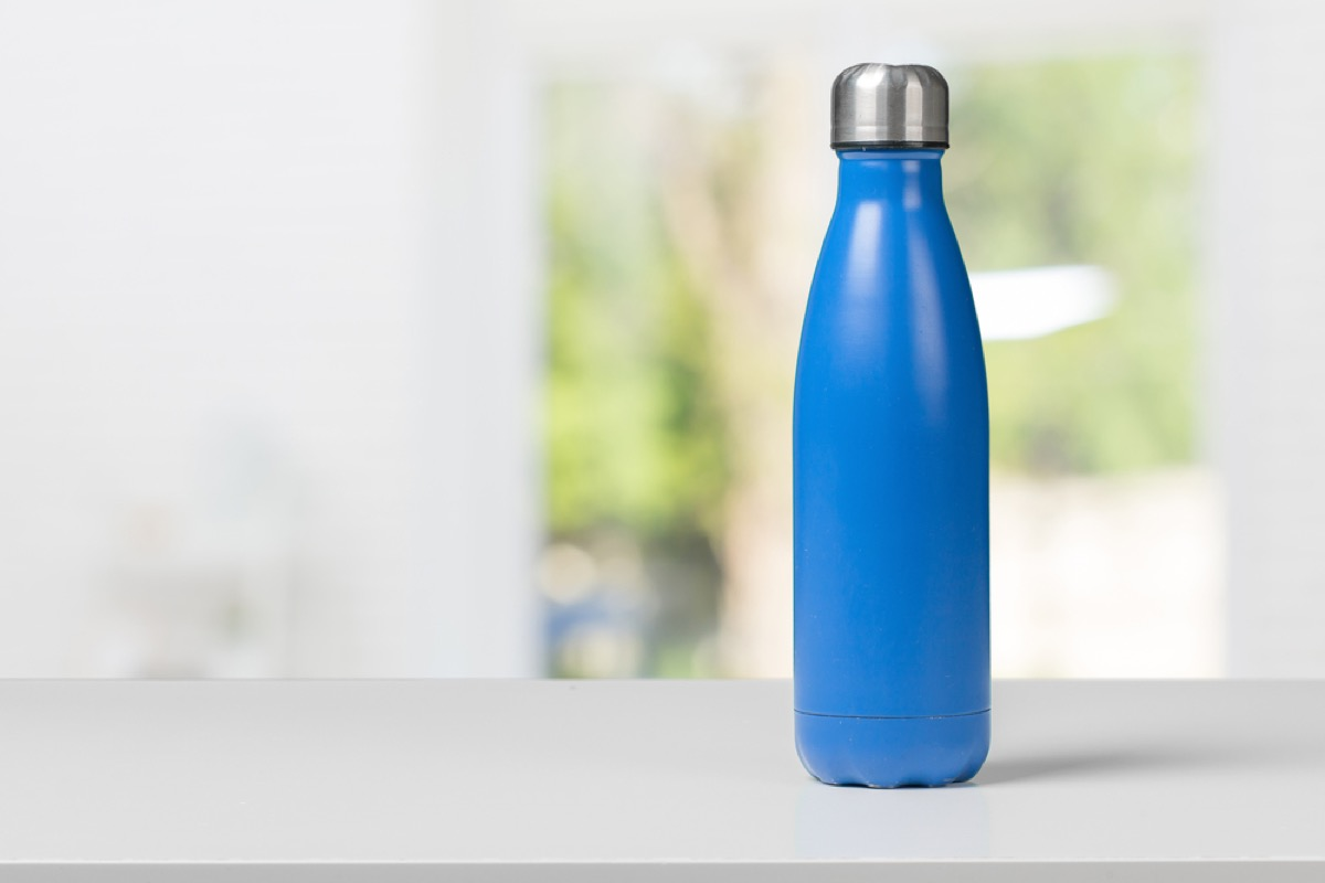 blue water bottle with silver top