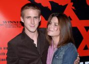 Sandra Bullock posing with Ryan Gosling at the premiere of The Believer at the Director Guild of America in Los Angeles. September 6, 2001