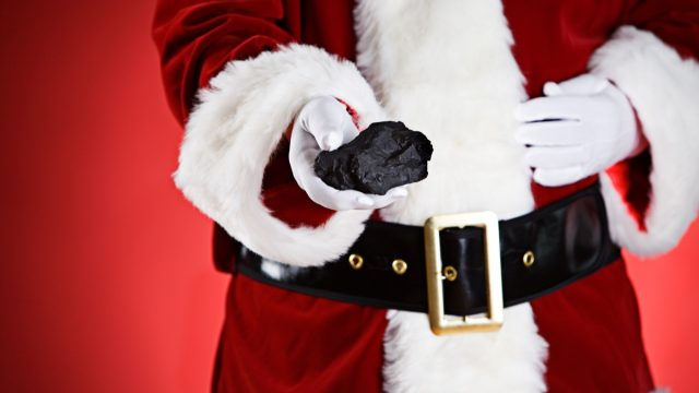 Santa giving kids lumps of coal for Christmas